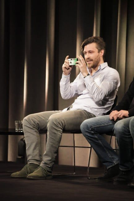 EyeEm Founder Florian Meissner taking a picture of the audience
