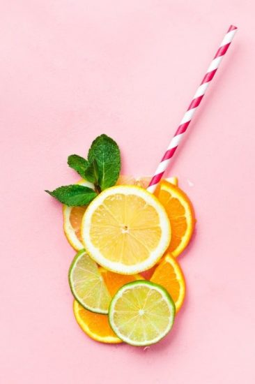 Citric Slices Straw Pink Background